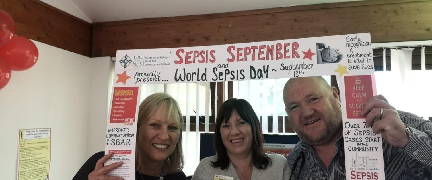 Employees celebrating world sepsis day