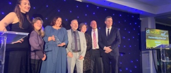 Employees collect transport award
