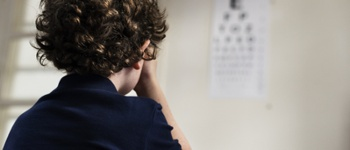 young boy having his eyes tested