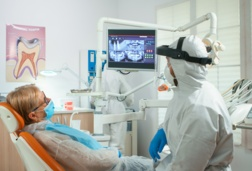 Dentist showing scan to a patient
