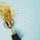 Trophy with gold confetti pouring out