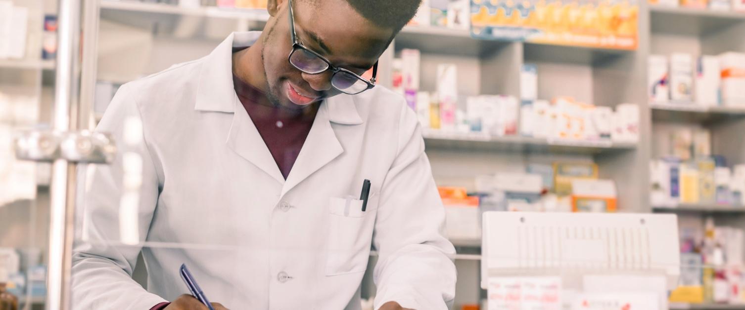 Pharmacist filling in form