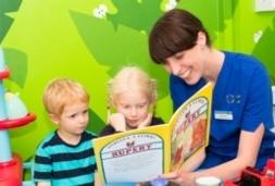 Nurse showing book to kid