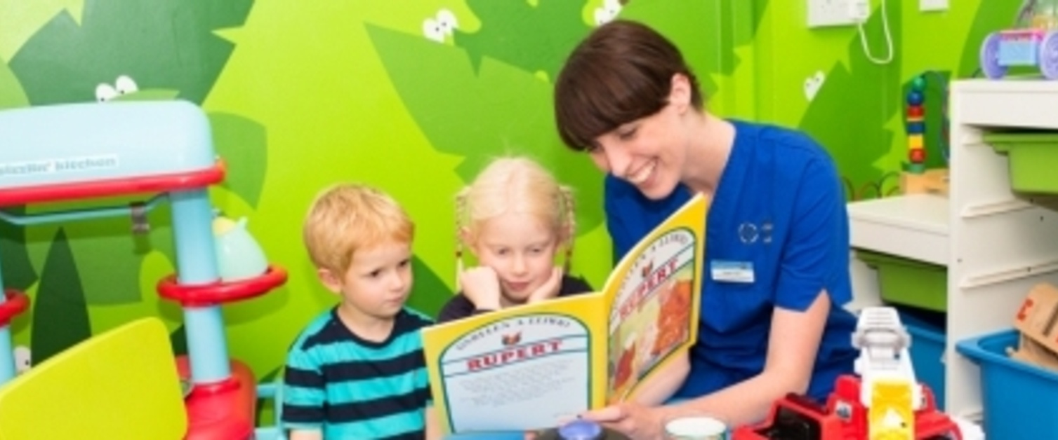 Nurse showing book to kid