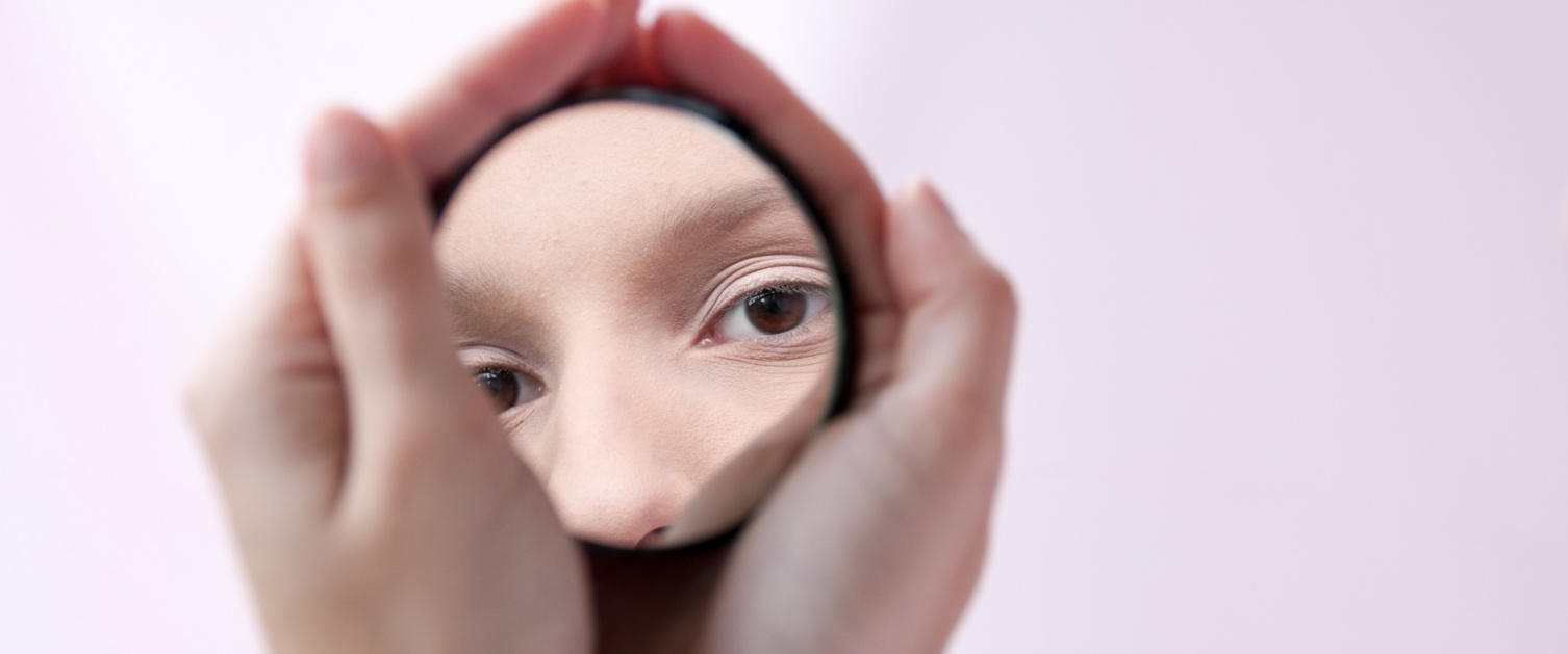 Lady mirroring herself