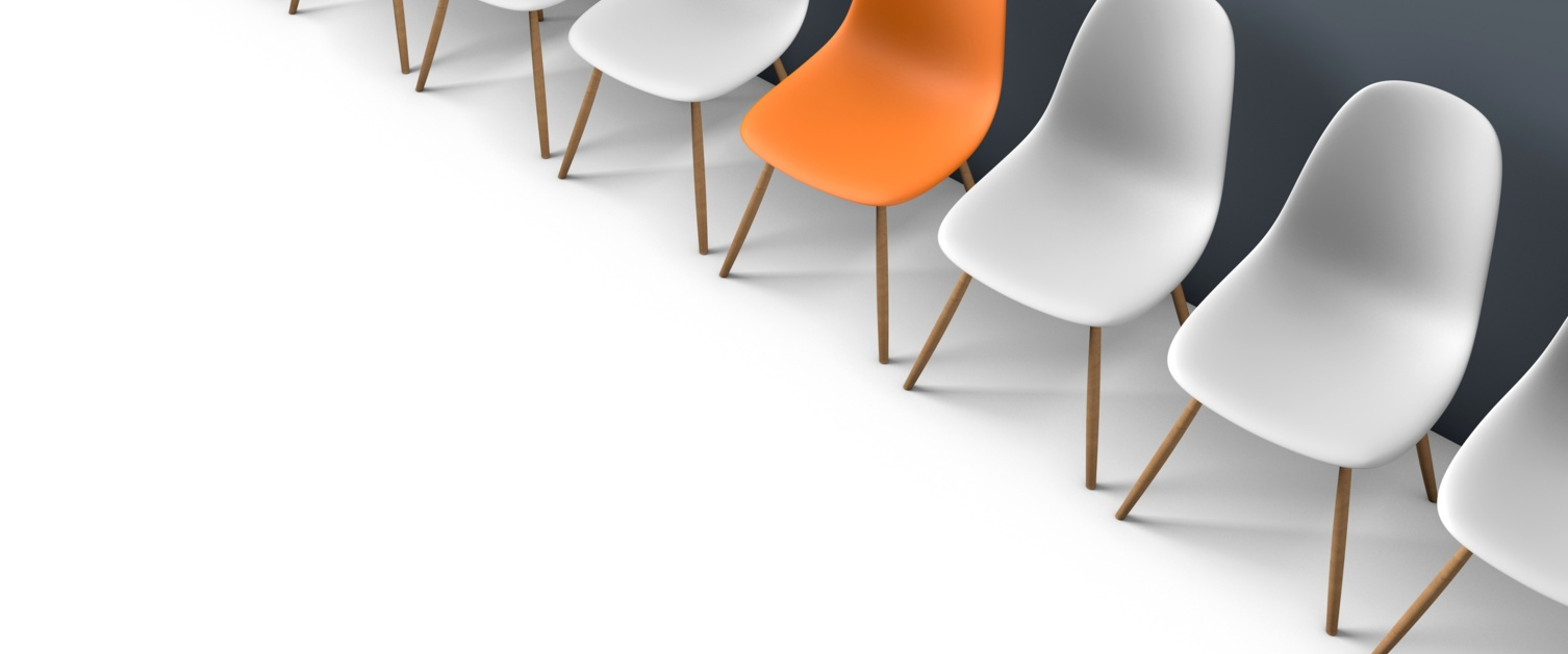 Orange chair between white chairs