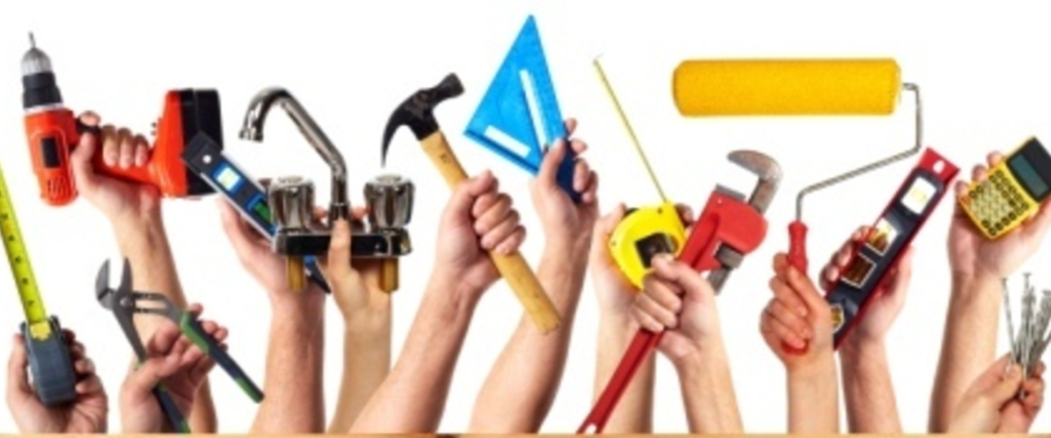 Hands holding work tools