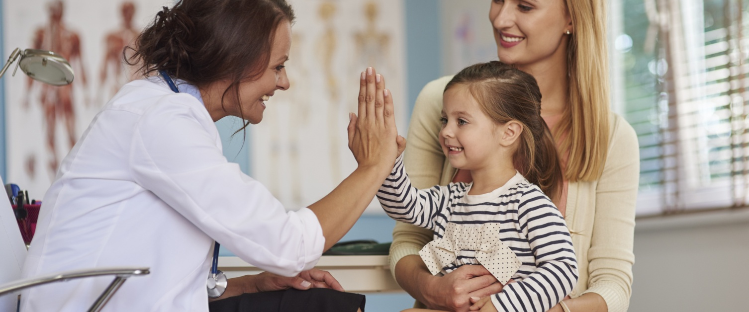 Doctor giving five to a kid