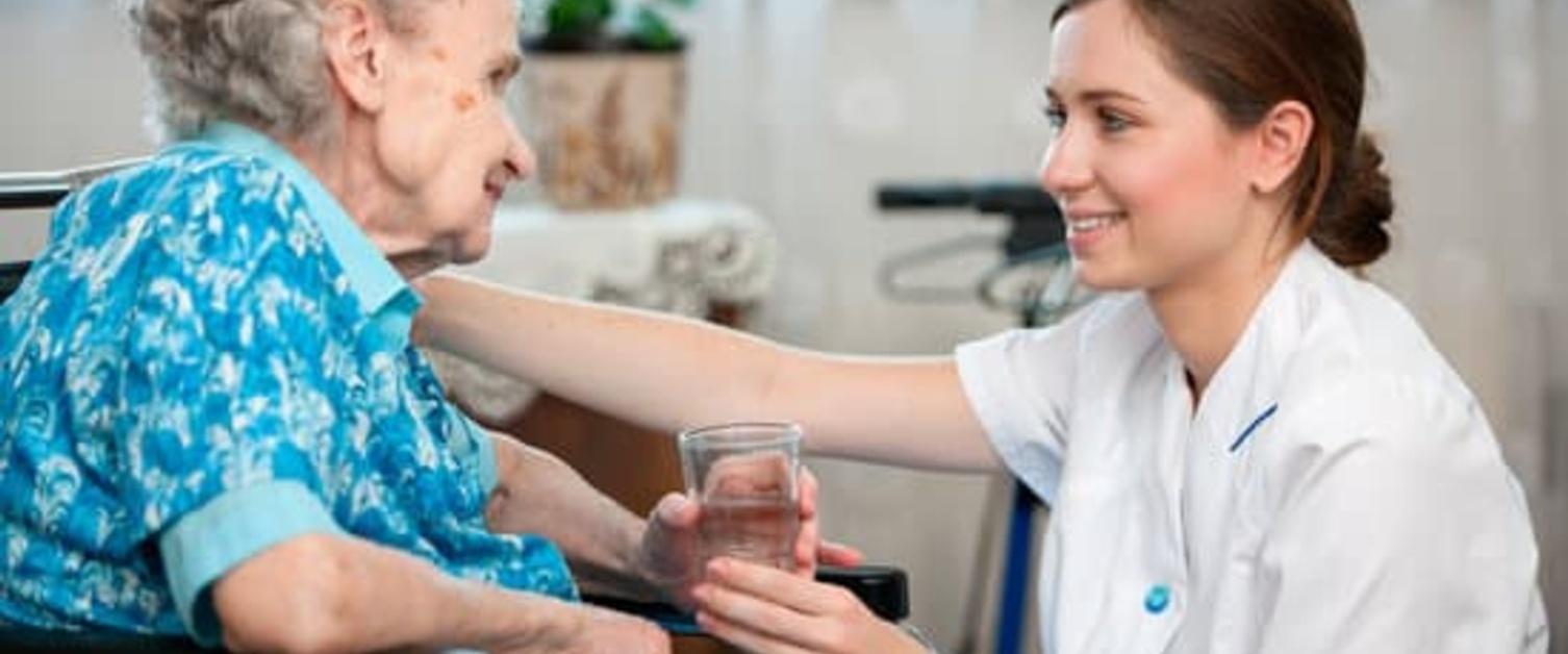Nurse helping an old woman