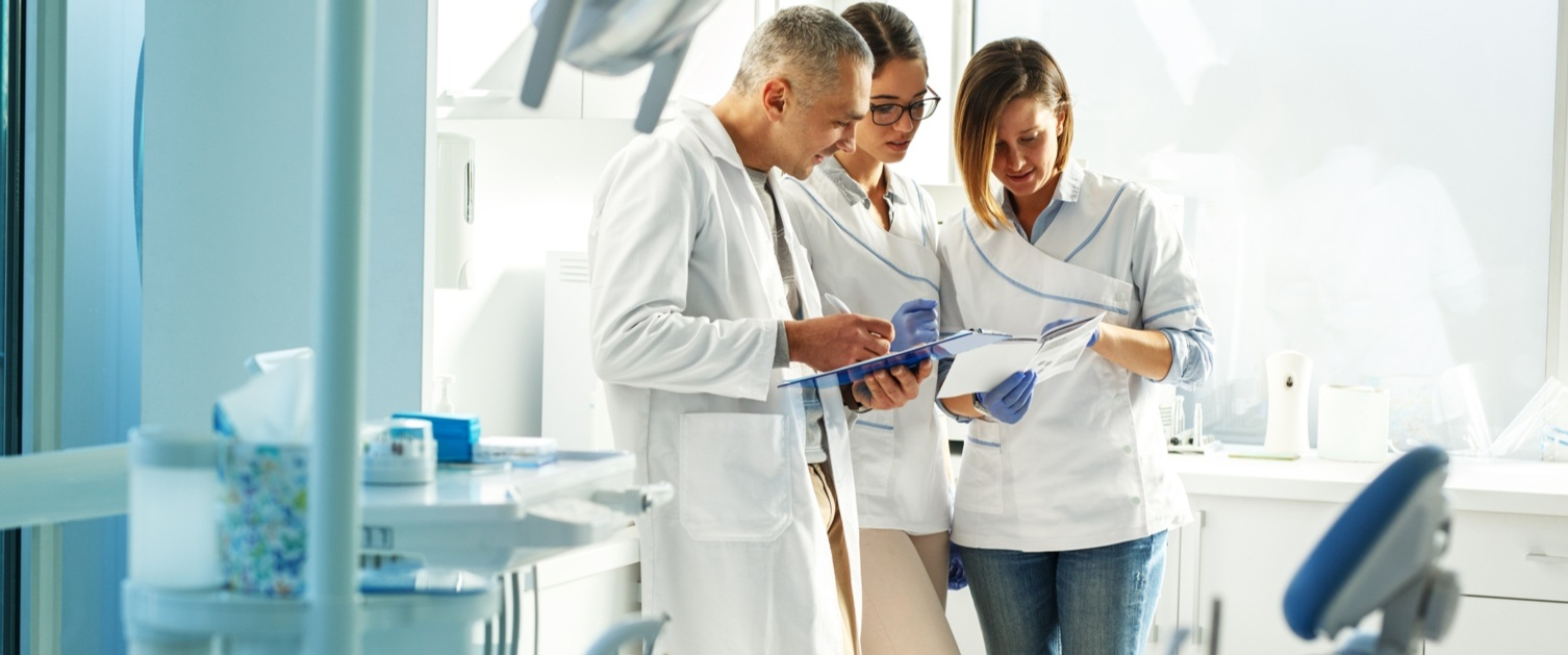 Group of dentists reading files