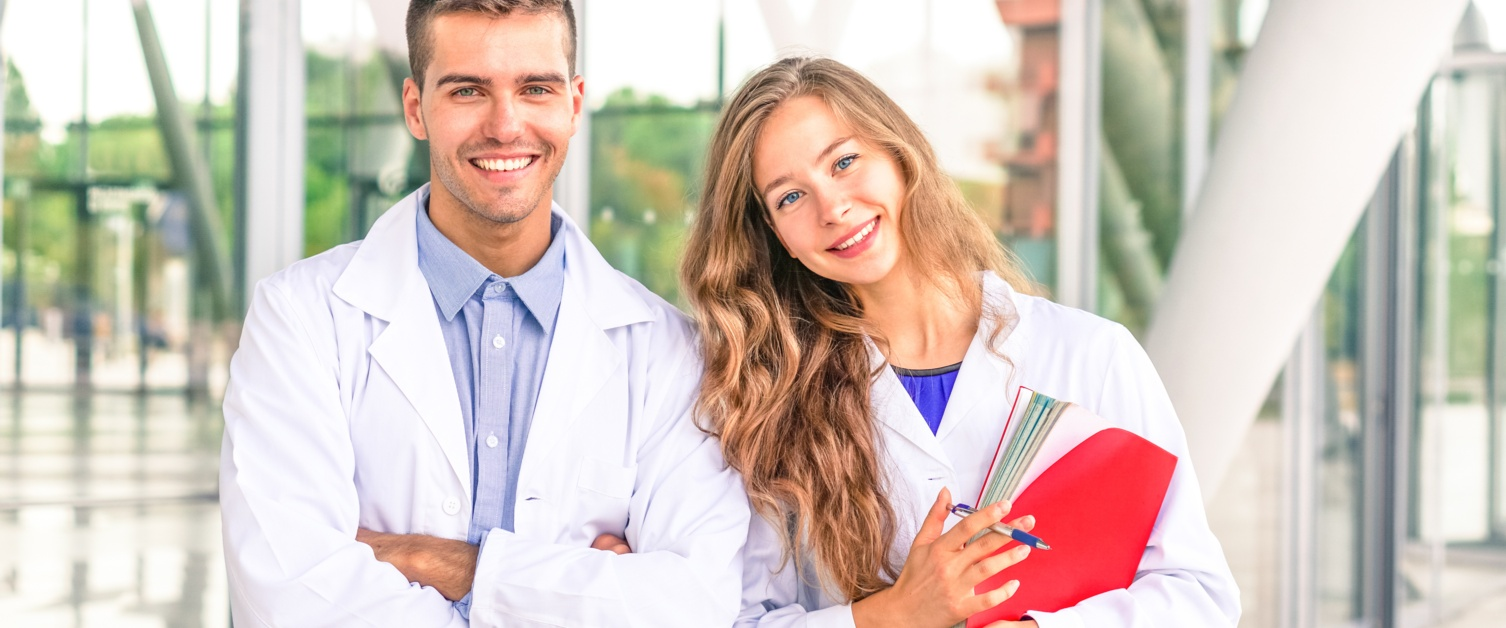 Two young doctors smiling