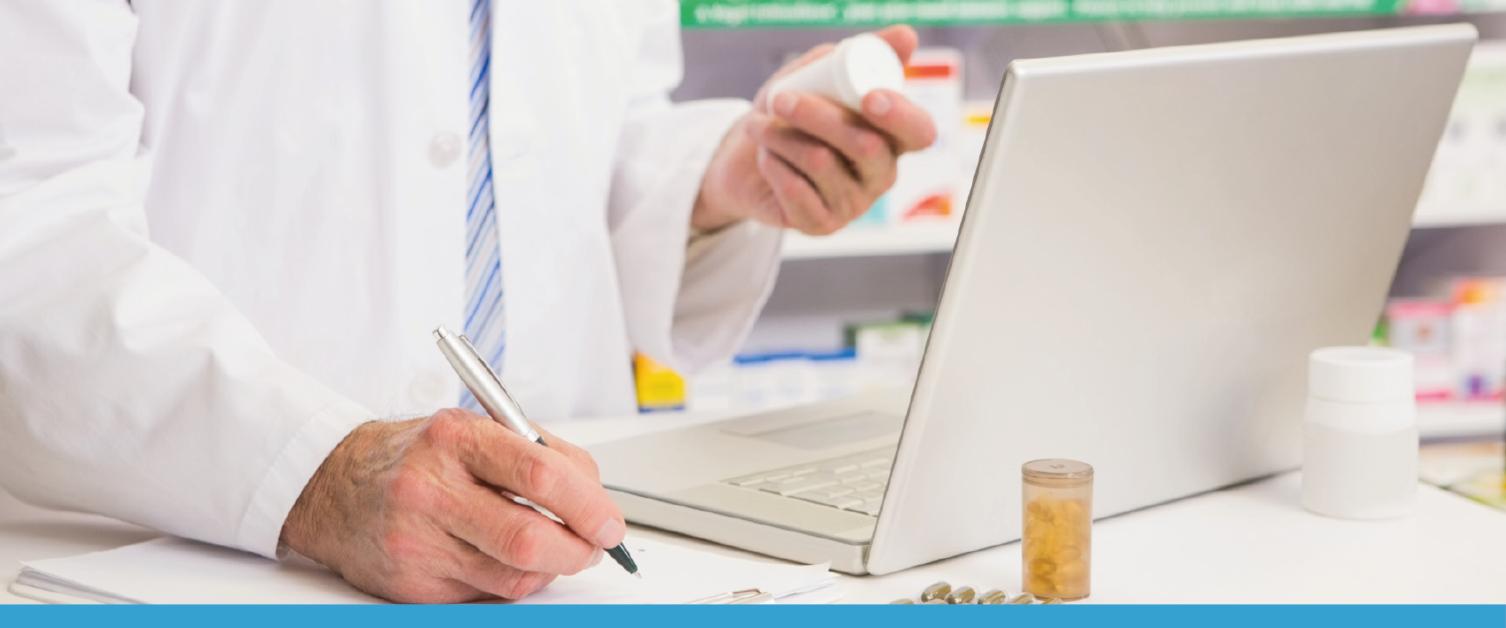 Pharmacist working on a laptop / Fferyllydd yn gweithio ar liniadur