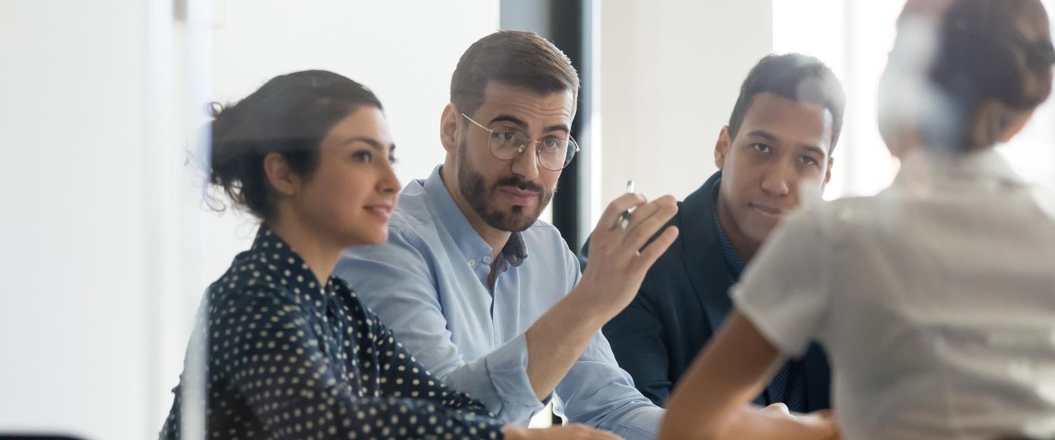 staff talking in a meeting