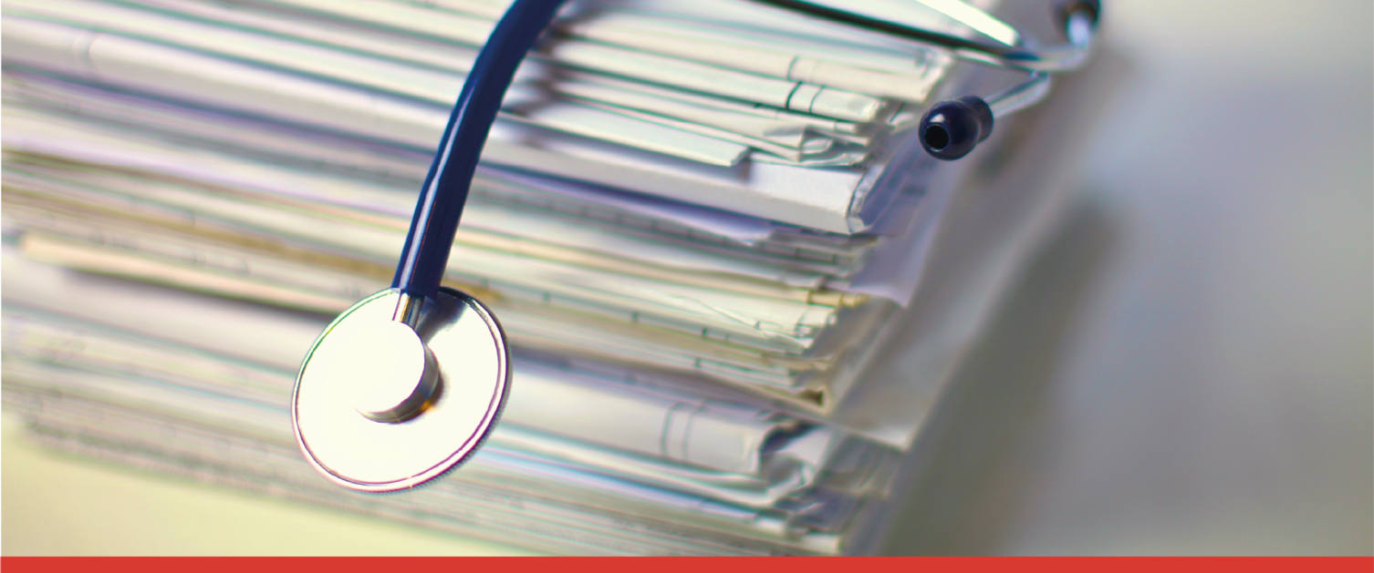 Stethoscope on top of medical records