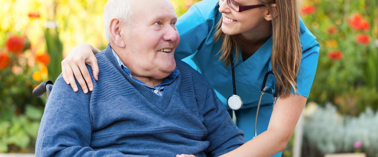 nurse helping old man