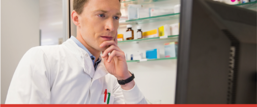 man looking at application for Inclusion in the pharmaceutical lList