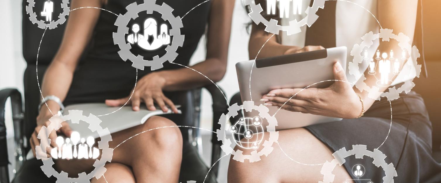 Women in meeting discussing Digital Workforce data