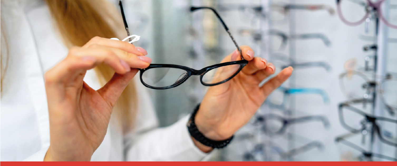 Woman looking at glasses in Opticians