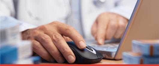 Pharmacist setting up electronic prescription returns on laptop
