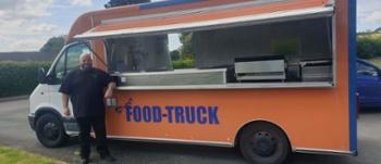 Johnal Simpson stood outside food truck