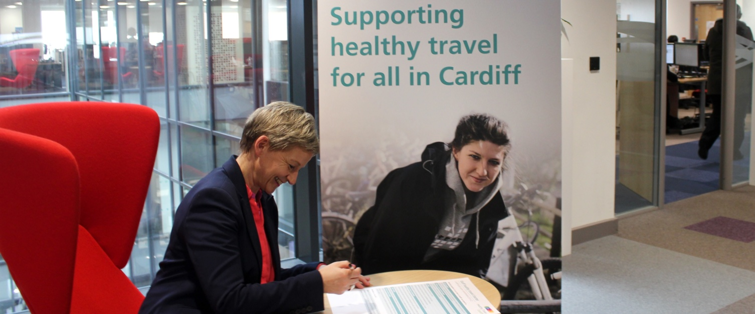 Tracey signs the Healthy Travel Charter