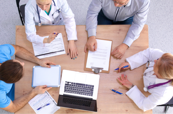 A group of professionals working around a table