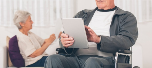 A patient using an iPad in a waiting are