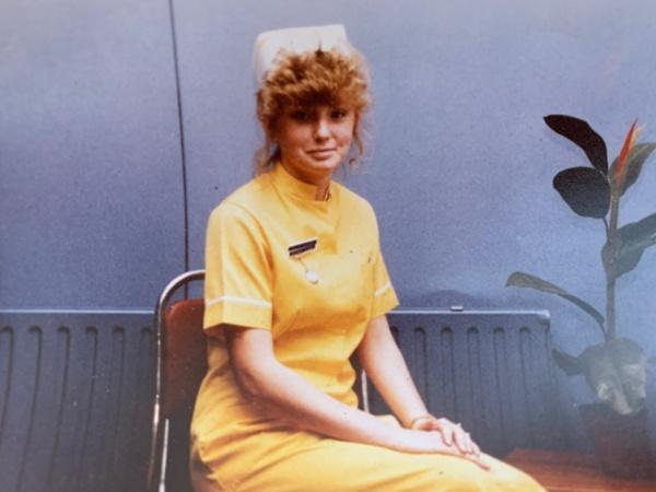 Image of nurse seated